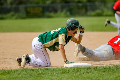 Oxford Hills' Braden Bean prepares to take second base after an errant pickoff attempt at first base.