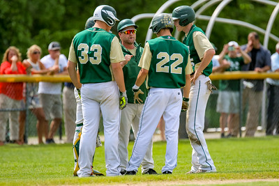 Oxford Hills coach Shane Slicer pulls his players together during a Camden Hills pitching change.