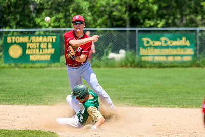 Bangor's George Payne turns two as Oxford Hills' Brayden Bean slides into the bag.