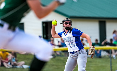 Lawrence third baseman Molly Fulson throws to first for the out.