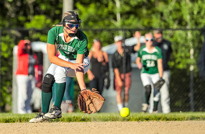 Oxford Hills' Madison Starbird fields a ball at second base before throwing to first to get the out.