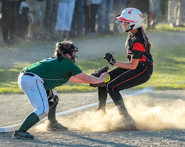 Oxford Hills' Kenzie Kahkonen tags out Skowhegan's Ashely Alward at third base.
