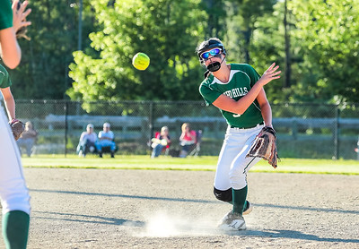 Oxford Hills' Madison Starbird gets the outs at first base on a slow roller early in the game.
