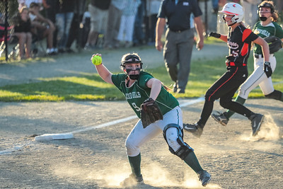 Oxford Hills' Kenzie Kahkonen fields a ground ball before getting the out at first base.