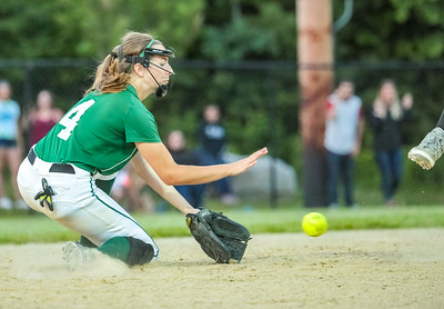 Oxford Hills' Kaisa Heikkinen firlds a ground ball late in the game before throwing to first for the out.