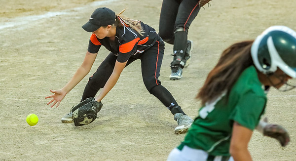 Skowhegan's Ashely Alward fields Oxford Hills' Anna Piirainen's bunt to get the first out of the 7th inning.
