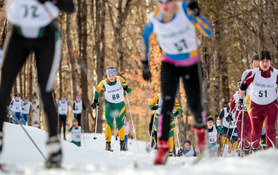 Oxford Hills' Olivia Swift works the long uphil at the start of the Oxford Hills Classic at Roberts Farm in Norway.