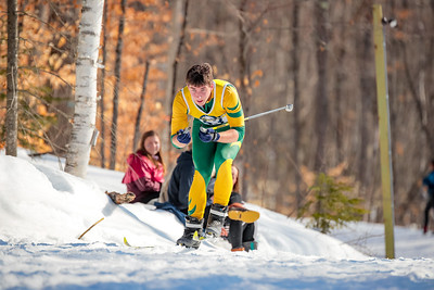 Oxford Hills' Nate McNutt steps through a turn as he approaches the half-way point of the race.
