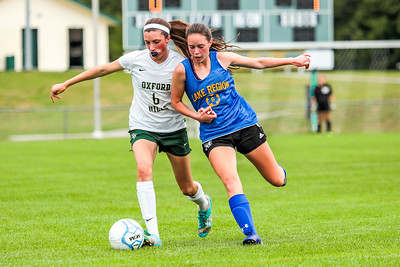 Arm Wrestling: As Caroline Burns jtries to get to the ball, her defender holds her back.