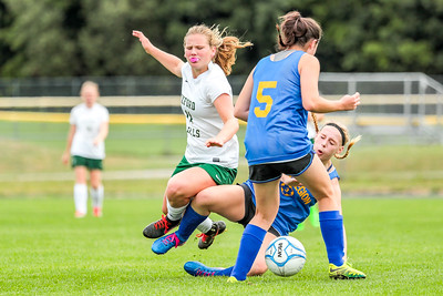 Tackle: Oxford Hills' Cecelia Dieterich gets dumped trying to advance the ball into the box. All photos up on Brewster's Photos.