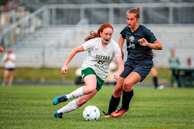 Oxford Hills' Julia Colby works the ball past Mt. Blue defender Gretchen Huish late in the first half of the game played at the Gouin Complex in South Paris.