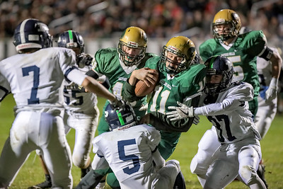 Oxford Hills' Colton Carson is tackled by Portland's Cillo Magno (37) and Ben Stasium.