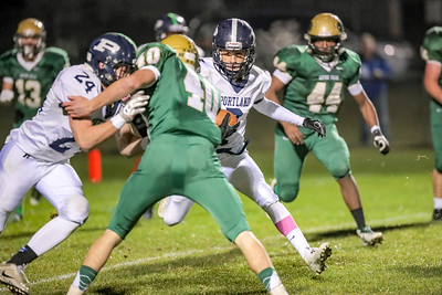 Portland's Vincent Pasquale looks to get around Oxford Hills' Jason Paradis.