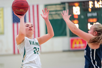 Oxford Hills' Maighread Laliberte pulls up for a shot late in the first quarter.