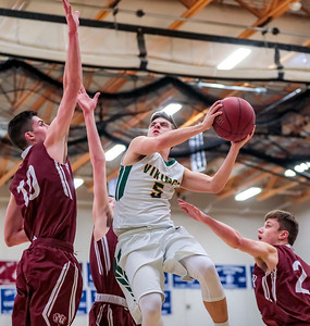 Oxford Hills' Garrett Record goes up against Bangors' Matt Fleming, Henry Westrich and Jason Smith to make the basket.