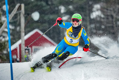 Spruce Mountain's Allison Acritelli crests a knoll at the top of the Titcomb Mountain course on her way to an MVC slalom championship win.