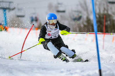 Traip Academy's Betti Stevens carves through the soft, afternoon snow mid way down the deadwall during her second run in the slalom event at the class A alpine championships at Black Mountain of Maine in Rumford. Stevens finished 10th in the event.