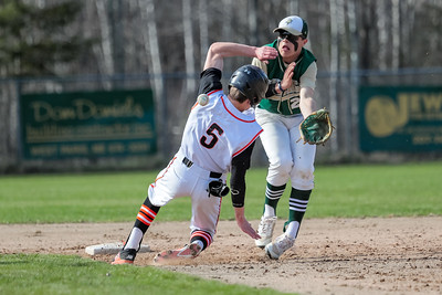Brunswick's Scout Masse takes a ball off the shoulder as he gets into second base safely on a steal while Oxford Hills' Janek Luksza tries to come up with the handle.