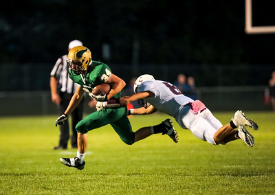 Edward Little' Jonathan Knight attempts to tackle Oxford Hills' Emerson Brown.