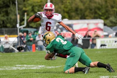 Oxford Hills' Alex Turner tackles Bangor's Eli Bradford on a swing pass from quarterback Zach Milliken.