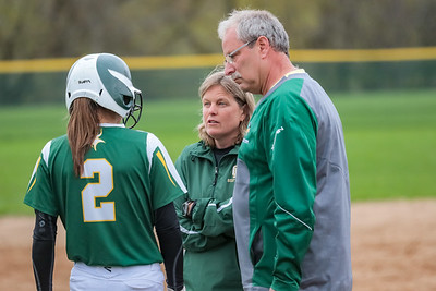 Oxford Hills' coaches Cindy Goddard and Dan Daniels talk with Kiara McLeod during a timeout