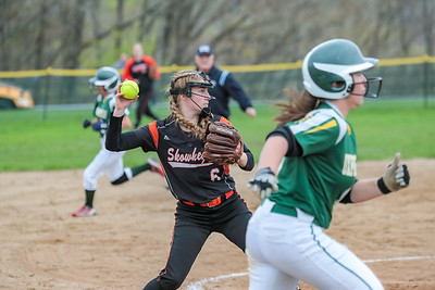 With Oxford Hills Madison Day running, Skowhegan's Sydney Ames gets ready to throw to first.