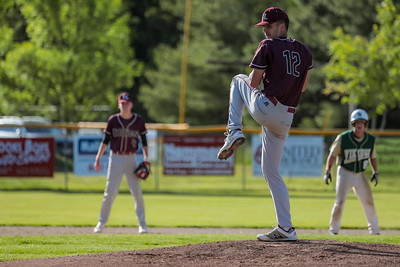Edward Little's Ethan Brown pitches in the bottom of the first.