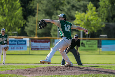 Oxford Hills' Colton Carson rears back in the first inning.