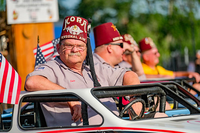Shriner John Mellor of Whitefield sits in his go cart before the start of the game.