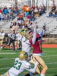 Thornton Academy's Hayden Pomerleau tries to come down with the pass defended by Oxford Hills' Elias Soehren (5) and teammate Ty LeBlond