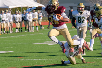 Thornton Academy's Isaac Ofielu goes up and over Oxford Hills' Dakota Grassi.