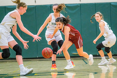 Defended by Vikings Jade Smedberg (left) and Cassidy Dumont, Bangor's Emi Streams chases after a loose ball during a Viking full-court press in the first quarter during their game in South Paris.
