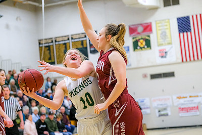 Oxford Hills' Cecelia Dieterich puts up a shot guarded by Bangor's Rowan Andrews during their game in South Paris.