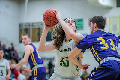 Oxford Hills' Patrick Paine drives to the hoop and Cheverus' Macklin Kelly tries to deny him.
