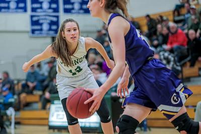 Oxford Hills' Brooke Carson puts defensive pressure on Cheverus' Jillian Lizaoote early in the game.