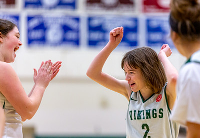 Oxford Hills' Brieana Smith celebrates her basket along with teammate Maddy Stack during their unified basketball game with Leavitt High School played in South Paris.