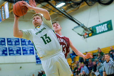 Oxford Hills' Isaiah Oufiero slashes to the basket getting by Bangor's Max Clark.