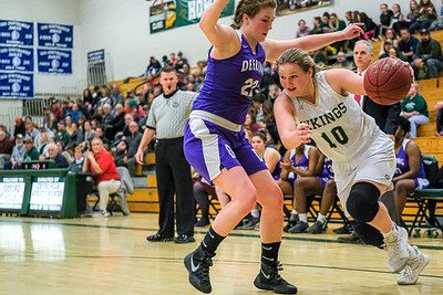 Oxford Hills' Cecelia Dieterich drives the baseline against Deering's Elizabeth Drelich.