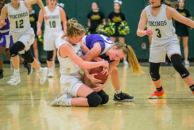 Oxford Hills' Jade Smedberg and Deering's Madison Alves battle for a loose ball early in the second half.
