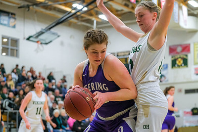 After a defensive rebound, Deering's Elizabeth Drelich attempts to escape the pressure of Oxford Hills' Jade Smedberg.