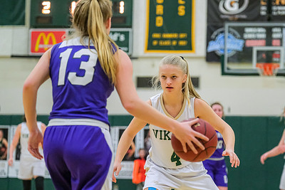 As Deering's Madison Alves brings the ball up court, Oxford Hills' Molly Corbett presses.