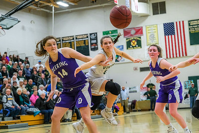 Oxford Hills' Brooke Carson tries to get by Deering's Livia Serappa to get the ball.