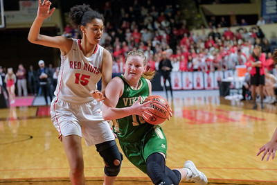Oxford Hills' Cecilia Dieterich drives by South Portland's Cora Boothby-Akilo.