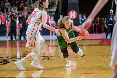 Oxford Hills' Cecilia Dieterich dribbles by South Portland's Margaret Whitmore midway during the 4th quarter as Oxford Hills used the stall to run out the clock.