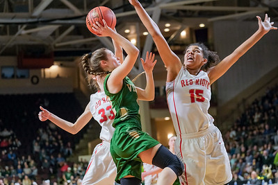 Oxford Hills' Brooke Carson goes up and gets the shot blocked by South Portland's Cora Boothby-Akilo.