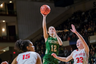 Oxford Hills' Brooke Carson goes up for a shot guarded by South Portland's Hylah Owen.
