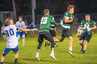 Oxford Hills' Addison Brown steps in front of a pass intended for Lewiston's Caed Langley.