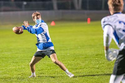 Lewiston quarterback Aiden Charest prepares to throw into the endzone.