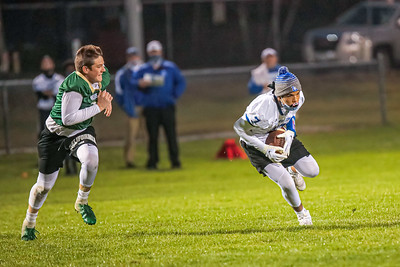 Lewiston receiver Keagan Whiting tries to get some yards after a catch defended by Oxford Hills' Eli Soehren.