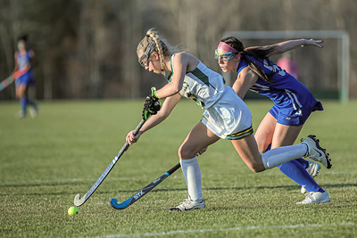 With Lewiston's Alexis Freeman pressing, Oxford Hills' Ally Slicer moves the ball to the sideline after Lewiston put on some pressure deep in Oxford Hills' zone.